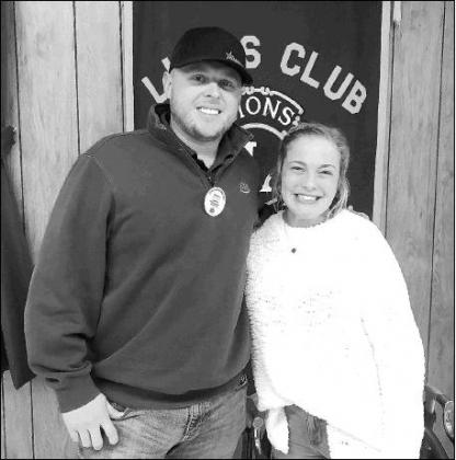 KHS JUNIOR Cora Taylor, right, Kingfisher County Distinguished Young Women winner, with Kingfisher Lions Club member Zach Meyer. Taylor was the guest speaker at last week's Lions Club meeting.             [KT&FP Staff Photo]