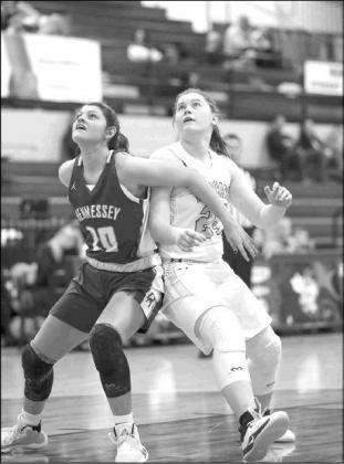 HENNESSEY'S Meagan Tillman (10) and Cashion's Issy Reeves (24) battle for position in the lane during their teams' quarterfinal game on Thursday.             [Photo by Russell                           Stitt/www.stitt.smugmug