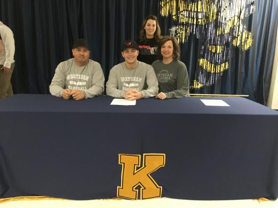 Kingfisher senior Creighton Bugg (seated center) will be playing baseball at NOC-Tonkawa next year after signing a National Letter of Intent on Wednesday. Bugg is seated with his stepfather Clint Snodgrass, mother Jennifer Snodgrass and standing is his si