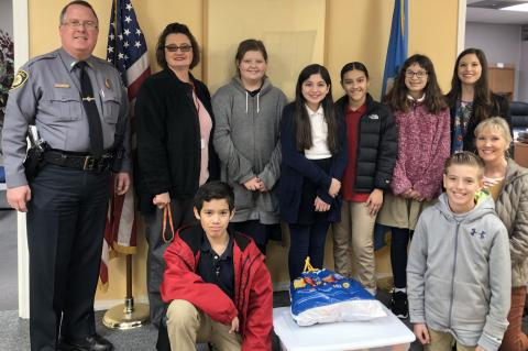 Pictured at the delivery to Kingfisher Police Department are, from left: front row, Alexander Garcia, Noah Hall and Sandy Murray; and back row, KPD Chief Dennis Baker, Sherry Pringnitz, Hannah Borelli, Mia Franco, Karen Munoz, Hailey Crosswhite and Makyla